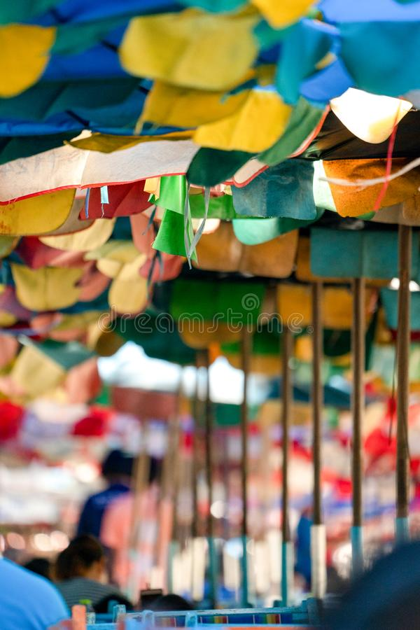 Old and tear Umbrella open to protect the sunshine for Tourists at the Bangsaen Beach Chonburi Thailand stock photography