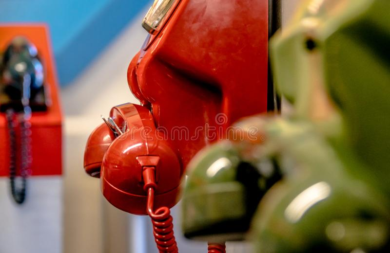 Old dial analogue colourful telephones. Old technology- dial analogue colourful telephones royalty free stock photo