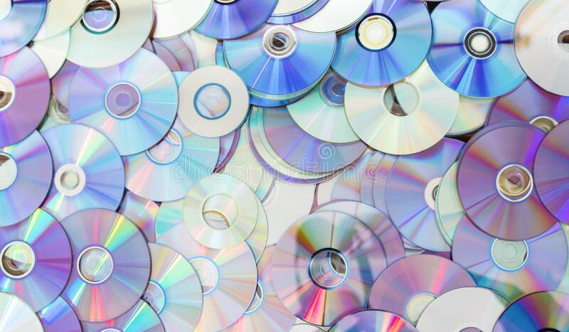Old technology, waste compact disc collection decoration for pattern. cd background concept. Old technology, waste compact disc collection decoration for stock photo