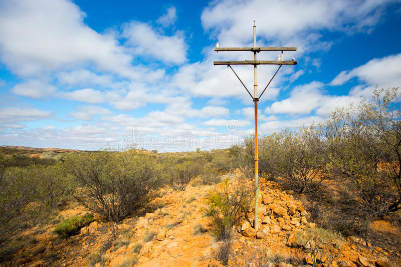Old Telegraph Pole. A view of the old Telegraph route near the Old Telegraph Station in Alice Springs, Northern Territory, Australia stock image