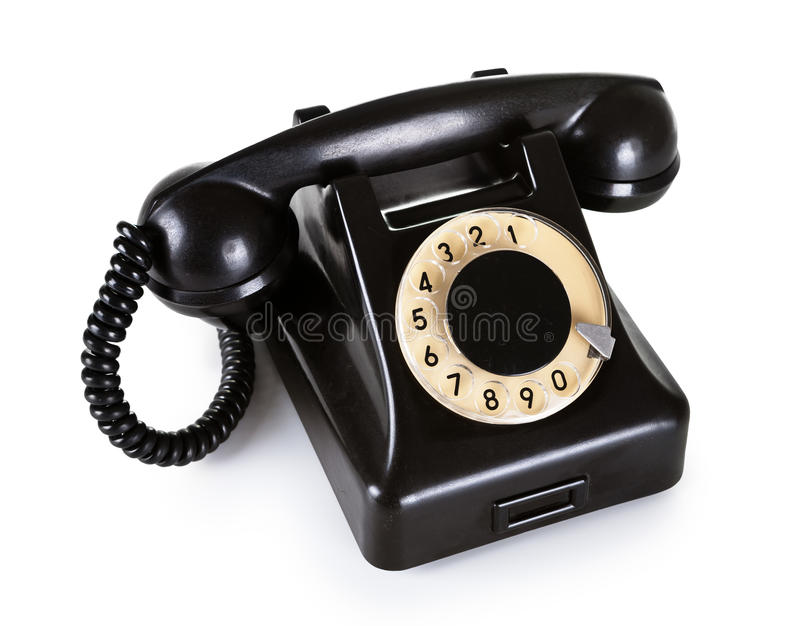 Old Telephone. Old black vintage telephone with rotary dial on white background royalty free stock photo