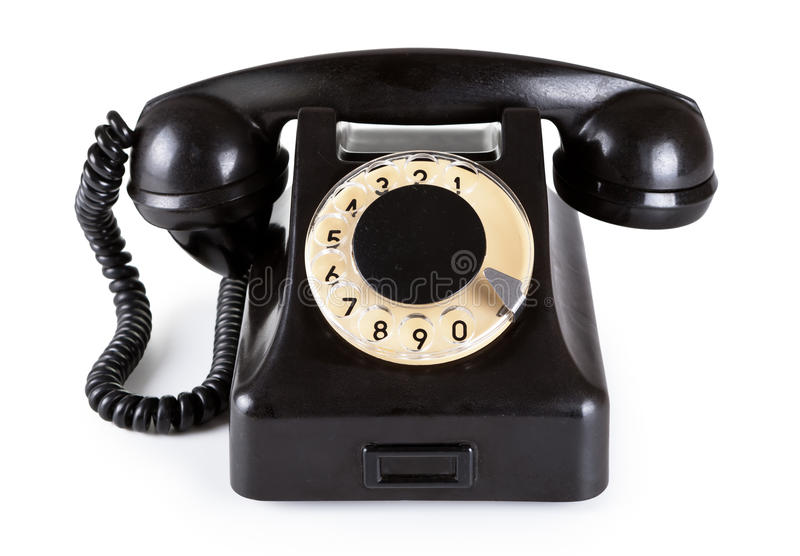Old Telephone. Old black vintage telephone with rotary dial on white background royalty free stock photography