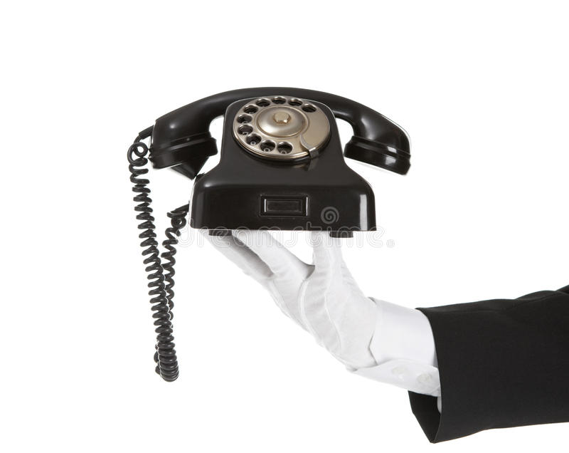 Old Telephone in battler hand stock images