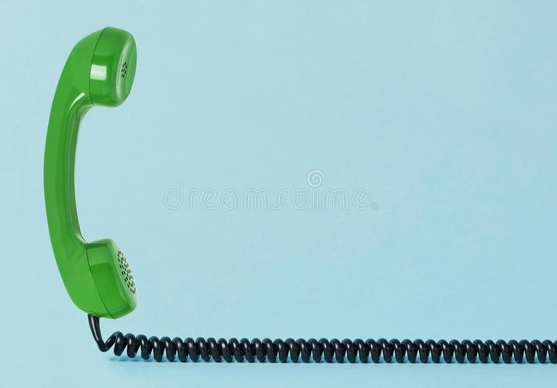 Old telephone receiver with cord royalty free stock images