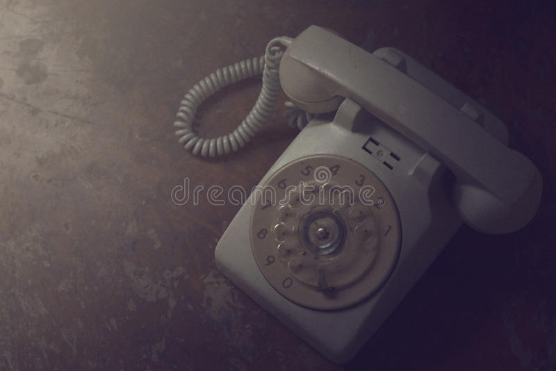 Old telephone on wooden table royalty free stock image