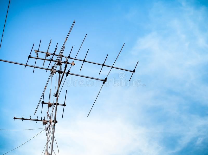 Old Analog Antenna For TV With Blue Sky Background  Stock
