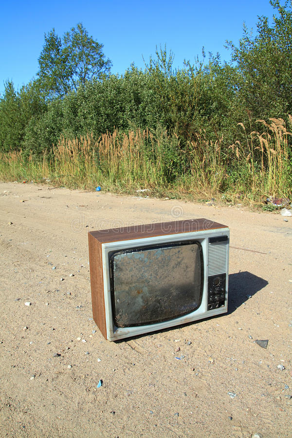 Old television set. On rural road stock photography