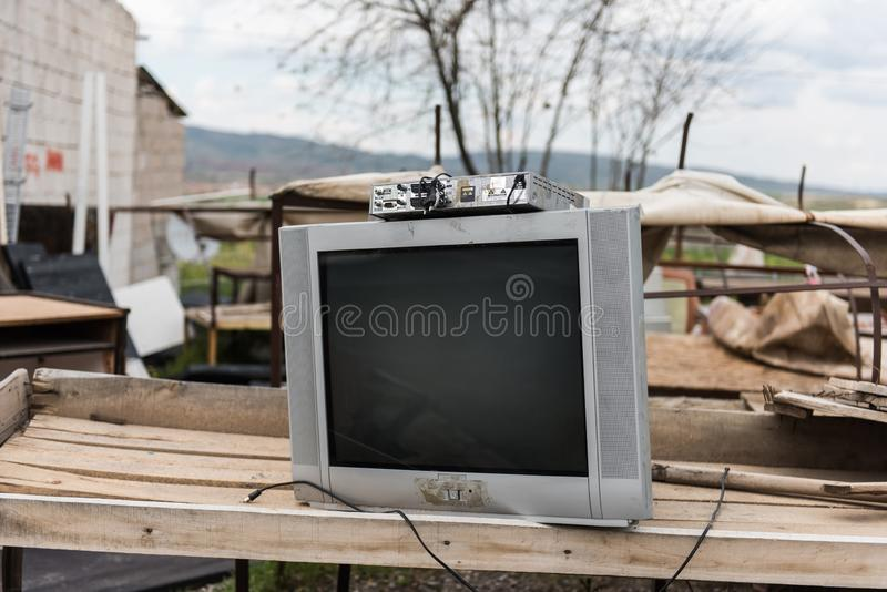 An old Television set, abandoned. An old and obsolete television set abandoned for the garbage dump. Concept of useless technology stock image