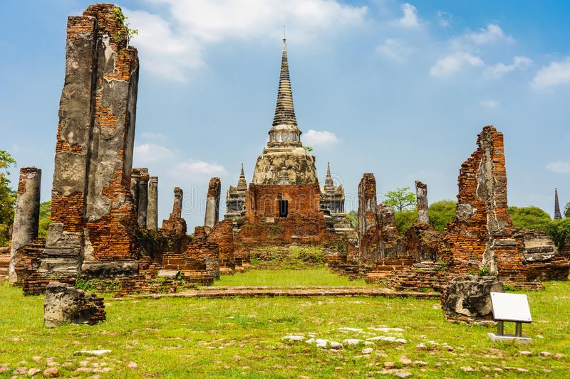 The old temple is beautiful in Ayutthaya.the many people are worship both Thai and foreigners. royalty free stock photo