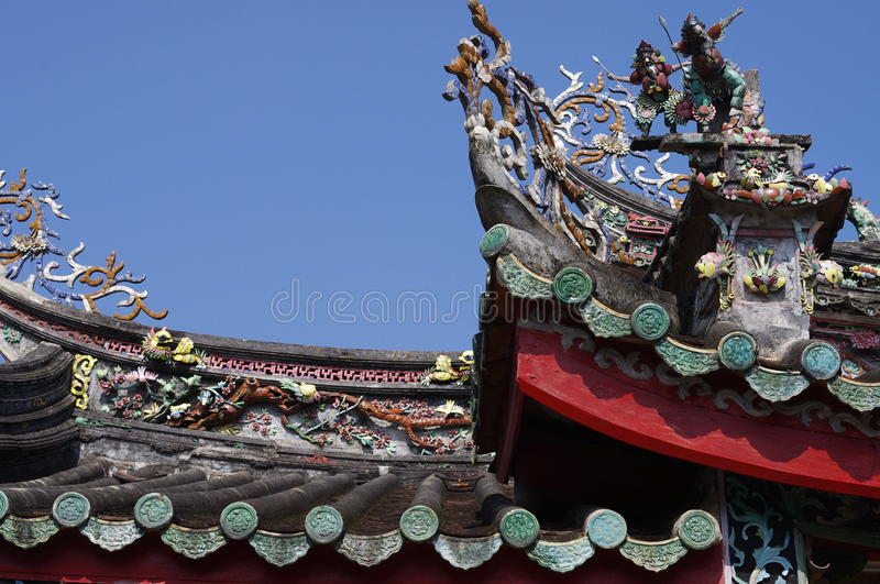 Mini-Sculpture Of Chinese Mythology On Top Of A Te Stock Photo