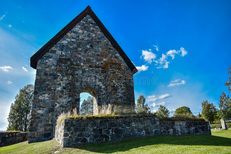 Old temple ruins. Stone, grey, building, exterior, historical, green, field, blu, sky, sunny, summer, day, outdoor, travel stock photo