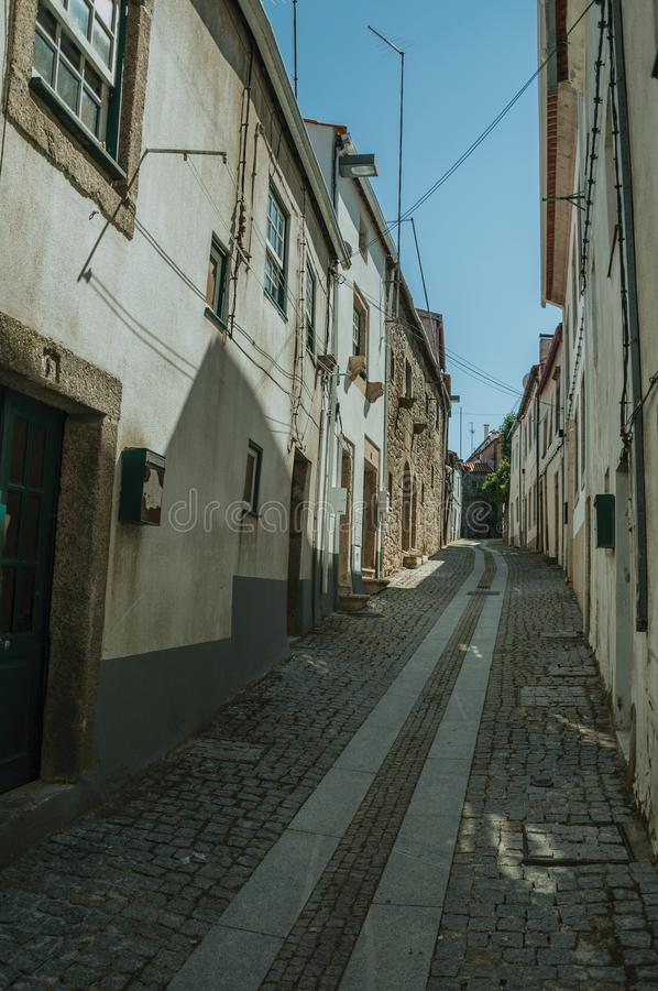 Old terraced houses on narrow deserted alley stock photo