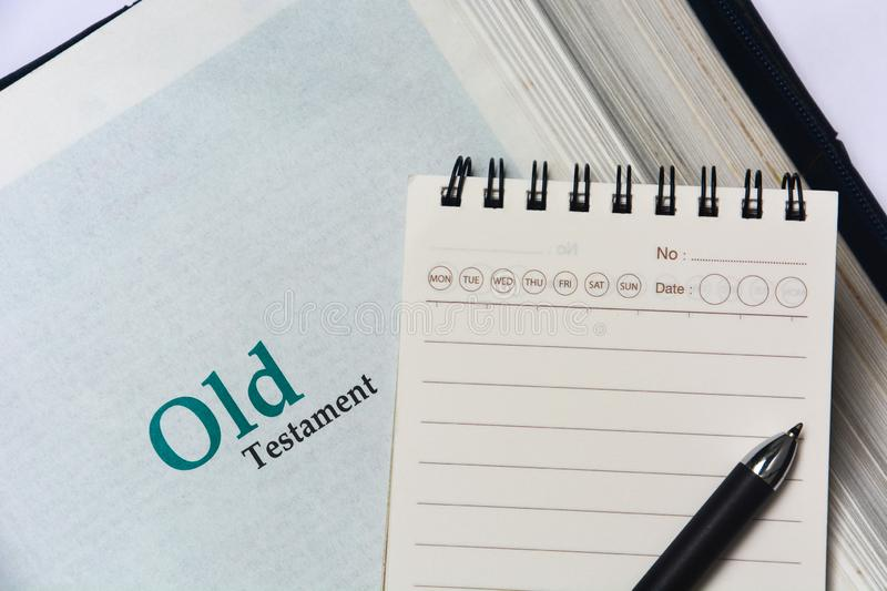 Old testament cover in Holy Bible with notebook and pen. Copy space stock photography