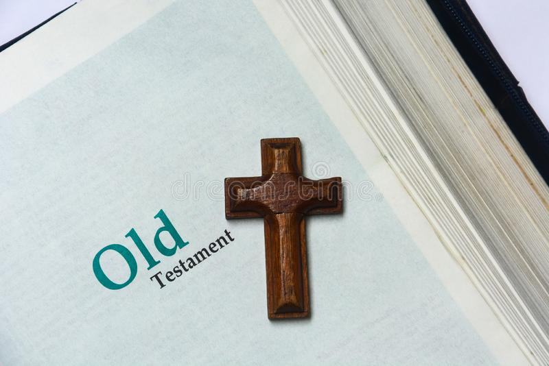 Old testament cover in Holy Bible with a wooden cross. Copy space royalty free stock photos