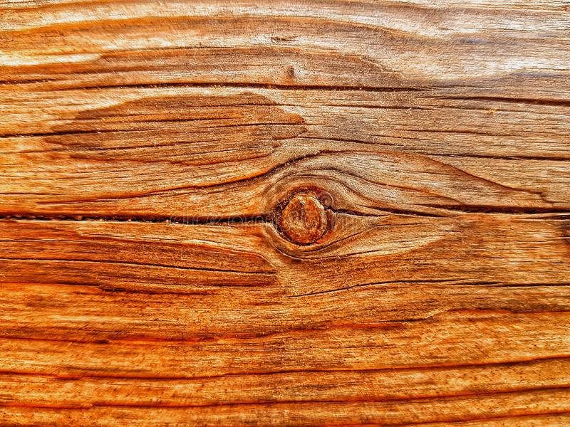 a piece of wood very cracked and with a knot in the center royalty free stock photos