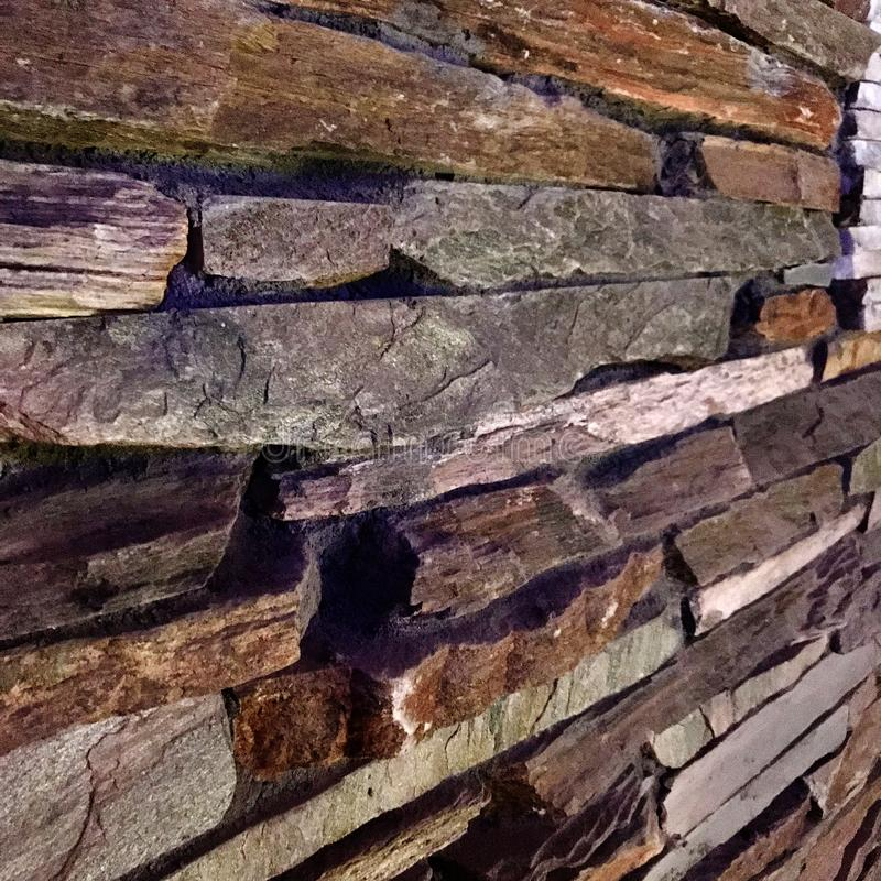 Old textured brick wall of stylish stones for home decor stock photography