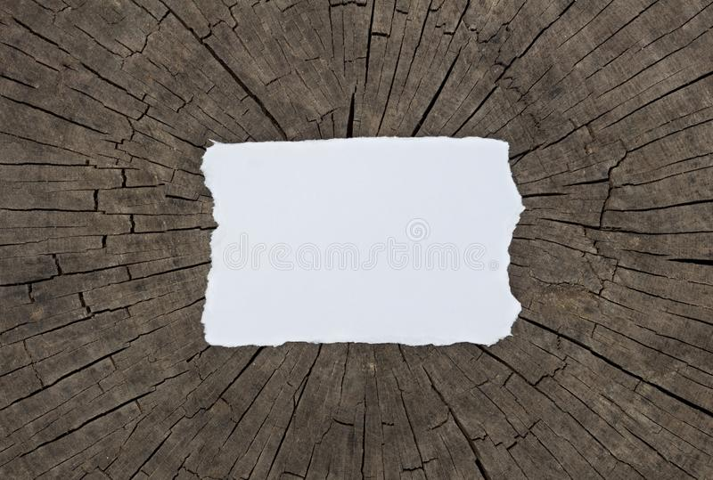 Old textured paper sheet on a dark wood table. Horizontal Mockup. royalty free stock photos