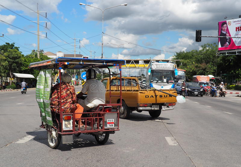 Old Thai couple riding a locally made motorcycle sidecar royalty free stock photos