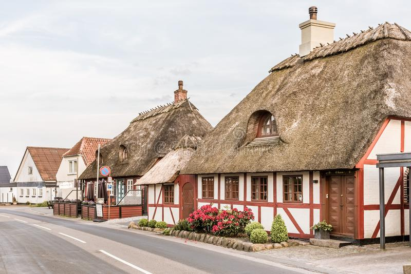 Old thatched half-timbered houses along the street to Thoro in Svendborg, Denmark. July 10, 2019 stock photo
