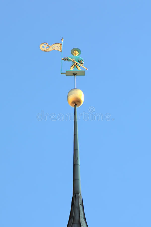 Old Thomas, a weather vane on the spire of Tallinn Town Hall stock photos