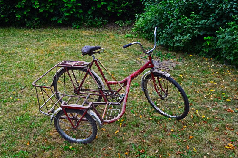An old three-wheeled bicycle. Of a homemade design stock photography