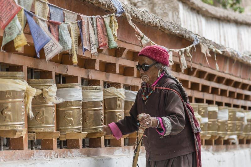 Old Tibetan women turning prayer wheels at a monastery royalty free stock photos