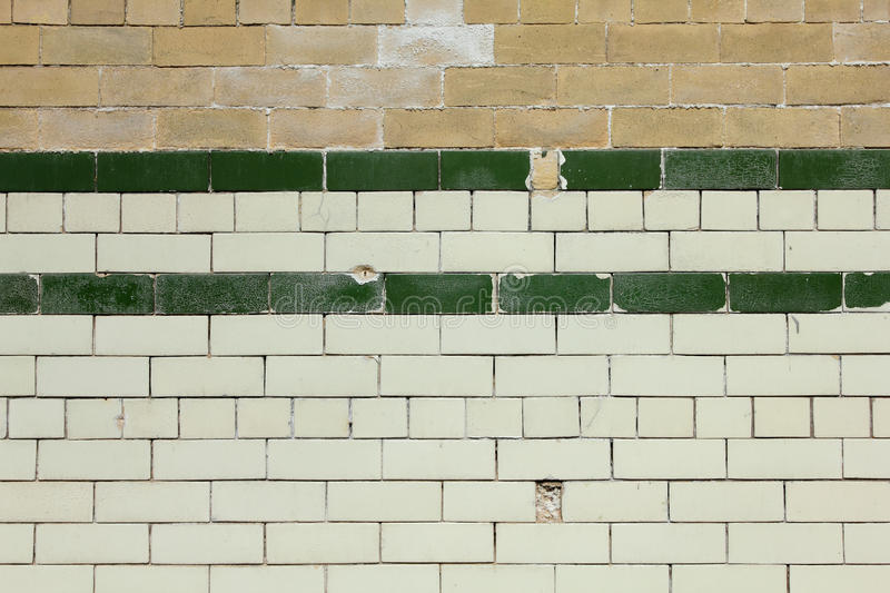 Old Tiled Brick Wall Background. Old chipped tiled brick wall royalty free stock photo