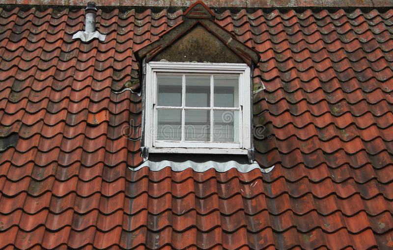 Old Tiled Roof. Old Tiled Slate Roof Close up with dorma window royalty free stock photography