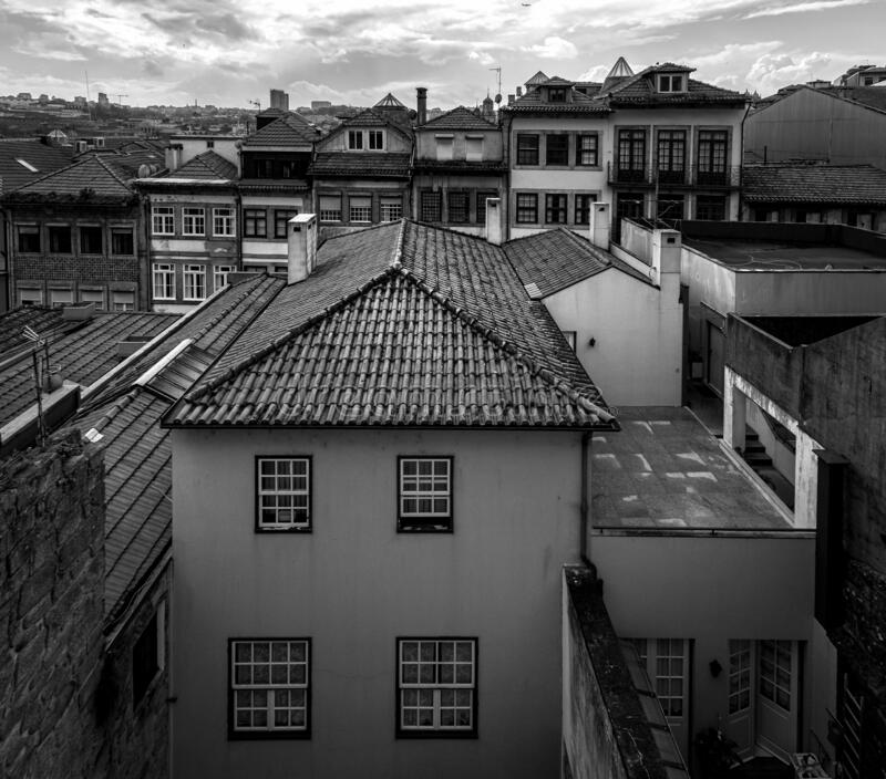Old tiled roofs of the old city of Porto. Portugal. Black and white. Old tiled roofs of the old city of Porto. Old Portugal. Black and white royalty free stock photos