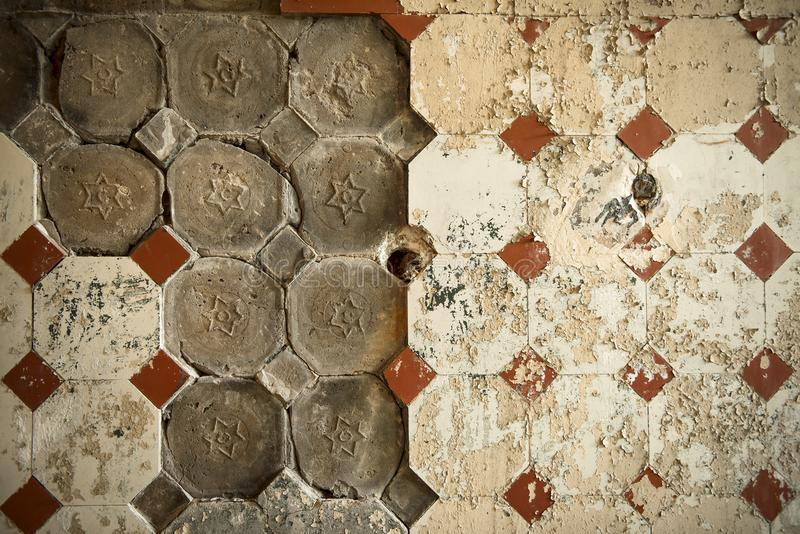Old tiles on an old wall stock photo