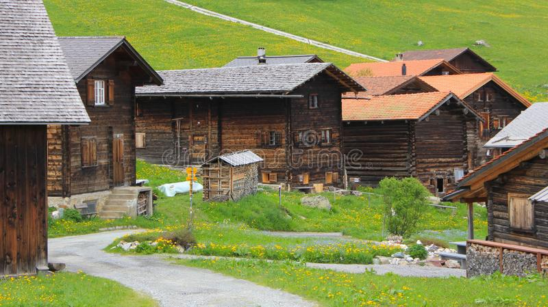 Old timber chalets in Obermutten, Switzerland. Old timber houses in Obermutten, Canton of Grisons, Switzerland stock image