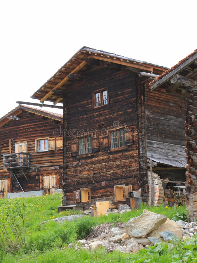 Old timber houses in Obermutten, Canton of Grisons, Switzerland. Old timber chalets in Obermutten, Switzerland royalty free stock photos