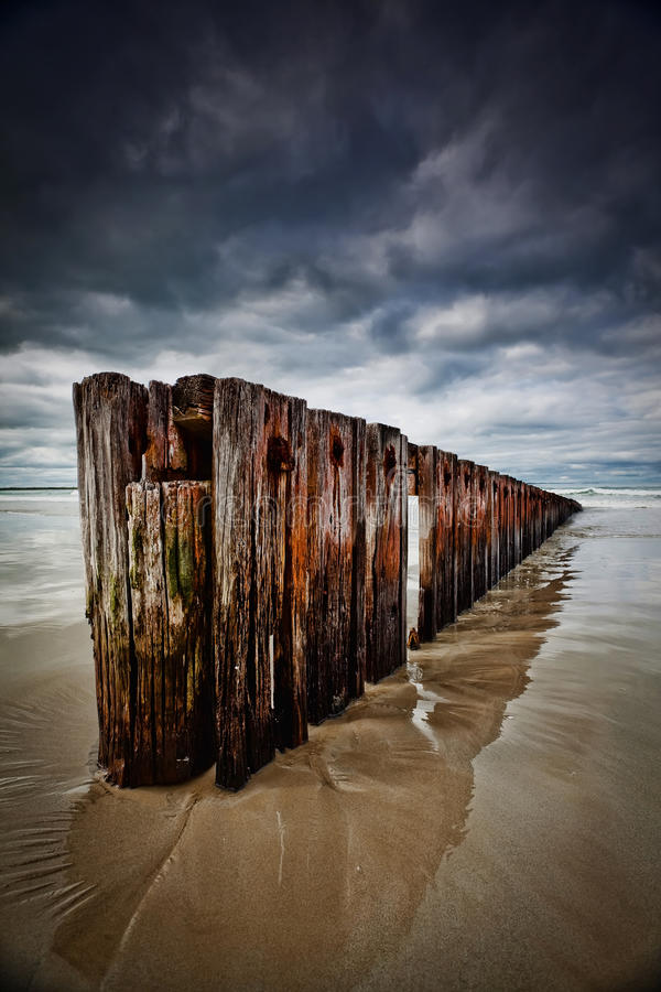 Free Old Timber Sea Barrier With Cloudy Sky Royalty Free Stock Photography - 25846827