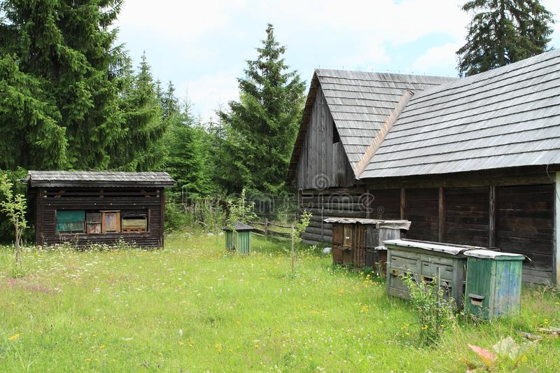 Old timbered village house with bee-hives royalty free stock images