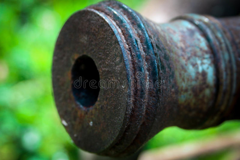Old time Cannon. This is photo is of the details of a historic cannon. This shows the rust and age of a huge piece of history royalty free stock photo