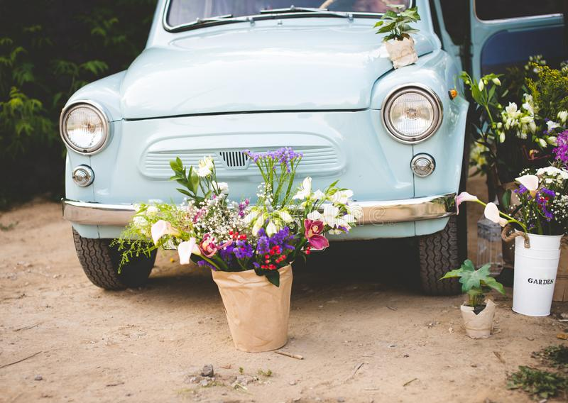 Old time Car with Just Married Sign Cans in Slow Motion.  royalty free stock photos