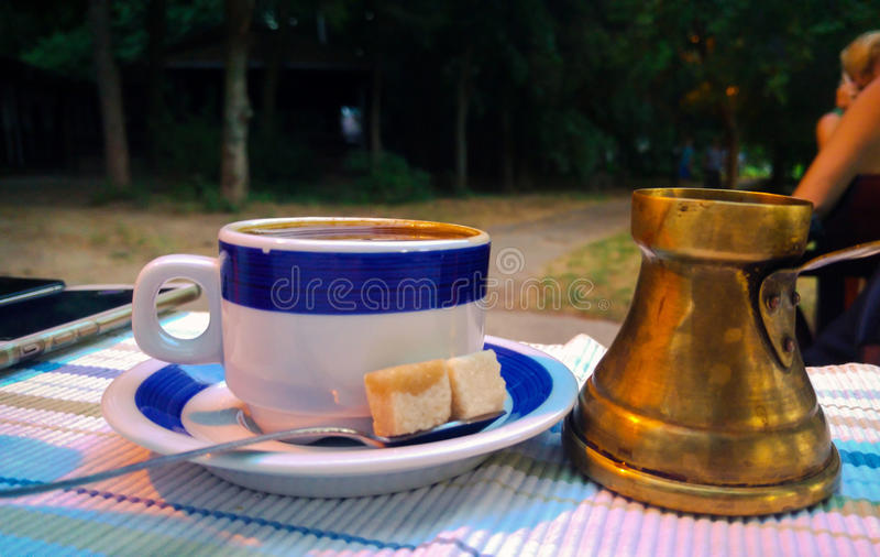 Old time coffee cup and a cup stock photography