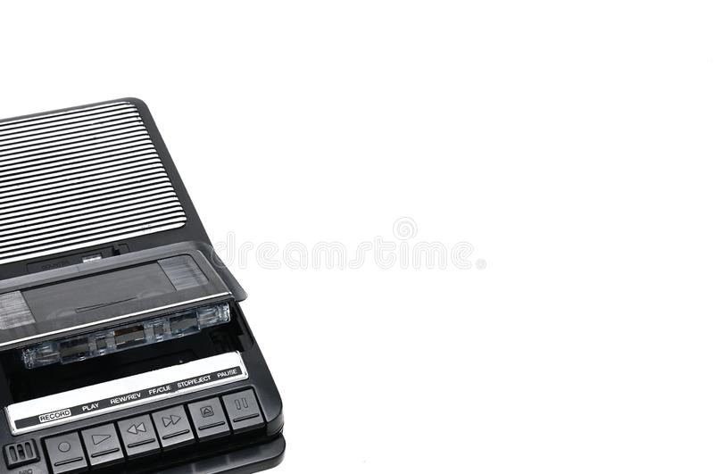 Old-time desktop type cassette recorder on white isolated background. Cassette tape recorder for recording and playing audio cassettes on an white isolated stock photo