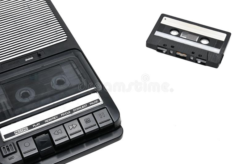 Old-time desktop type cassette recorder on white isolated background. Cassette tape recorder for recording and playing audio cassettes on an white isolated royalty free stock photos