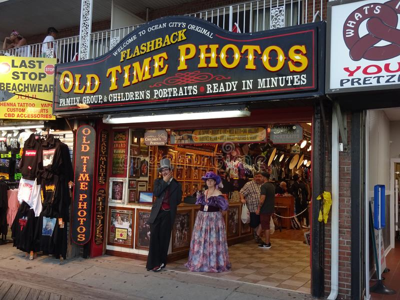 Old Time Photos in Ocean City Maryland. Photo of old time photos business at the boardwalk in ocean city maryland at dusk on 8/29/19.  Here you can have an old stock photography