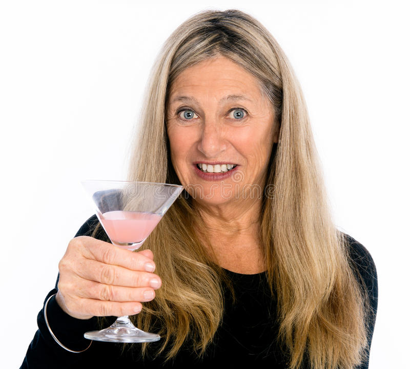 Old Timers Happy Hour!. Senior woman holding cocktail on isolated white background stock photography