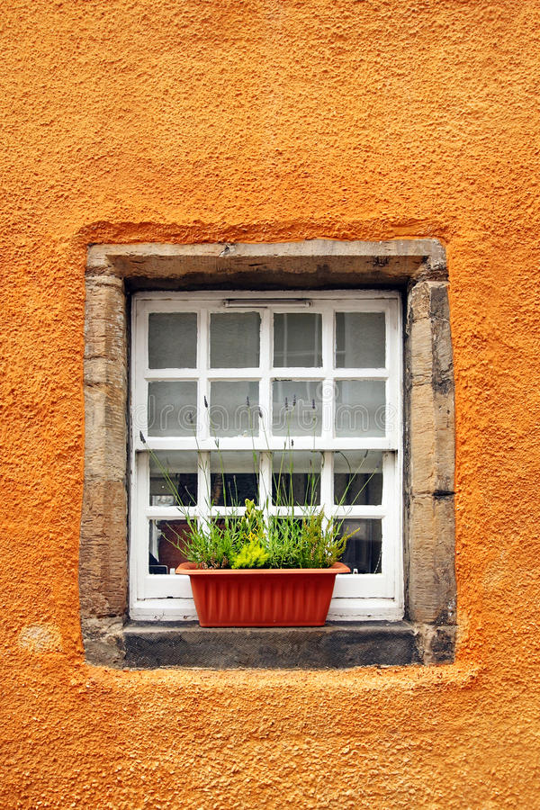 Old tiny windows in 6th century cottage. Culross is a former royal burgh in Fife, Scotland founded in 6th century royalty free stock photo