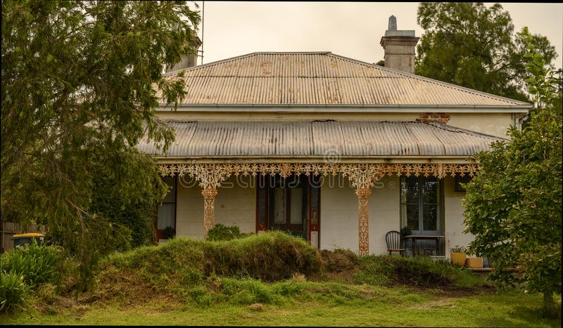 Old and tired house in Nowra. In Nowra, Australia stand a few old homes all in need of restoration. This old single story house in the town has been a beautiful royalty free stock photo