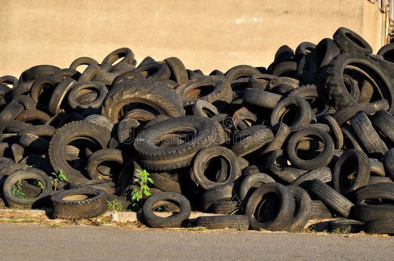 Old tires. Old used rubber tires stack in storage royalty free stock image