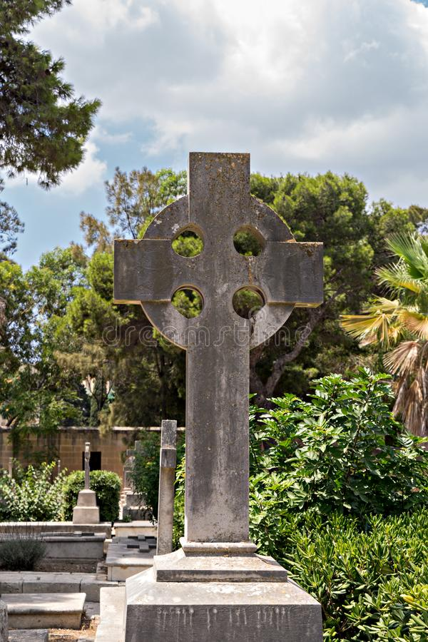 Old tombstone with Celtic cross an ancient war cemetery royalty free stock image