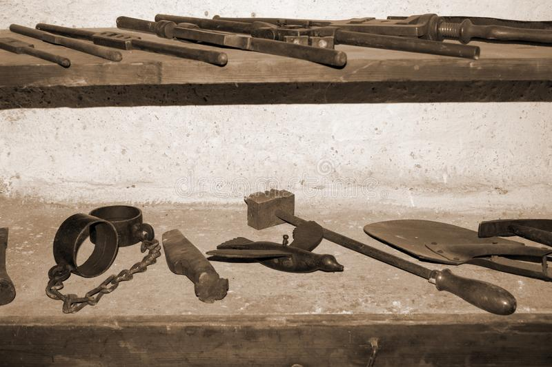 The old tools in the blacksmiths shop royalty free stock photography