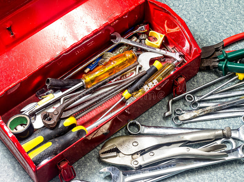 Old tools and red tool box stock photography