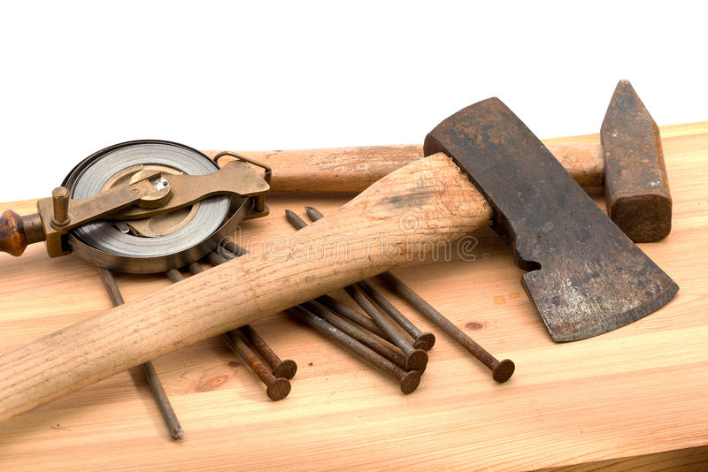 Old tools. Old used tools on the wooden desk royalty free stock photos