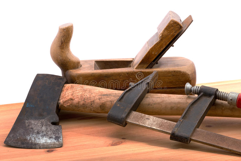 Old tools. Old used tools on the wooden desk stock photo