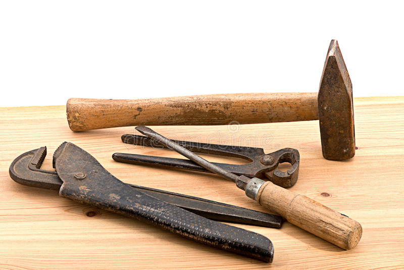 Old tools. Old used tools on the wooden desk royalty free stock photo